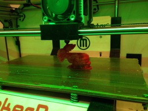 It's ALIVE! First print! I had to adjust the belt, as you can see it slipped. The second print worked great!