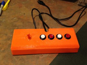 A finished controller in orange plastic.