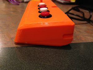 Side view, note the lovely buttons, and notch. It is so it will fit like the original on the front of the Vectrex.